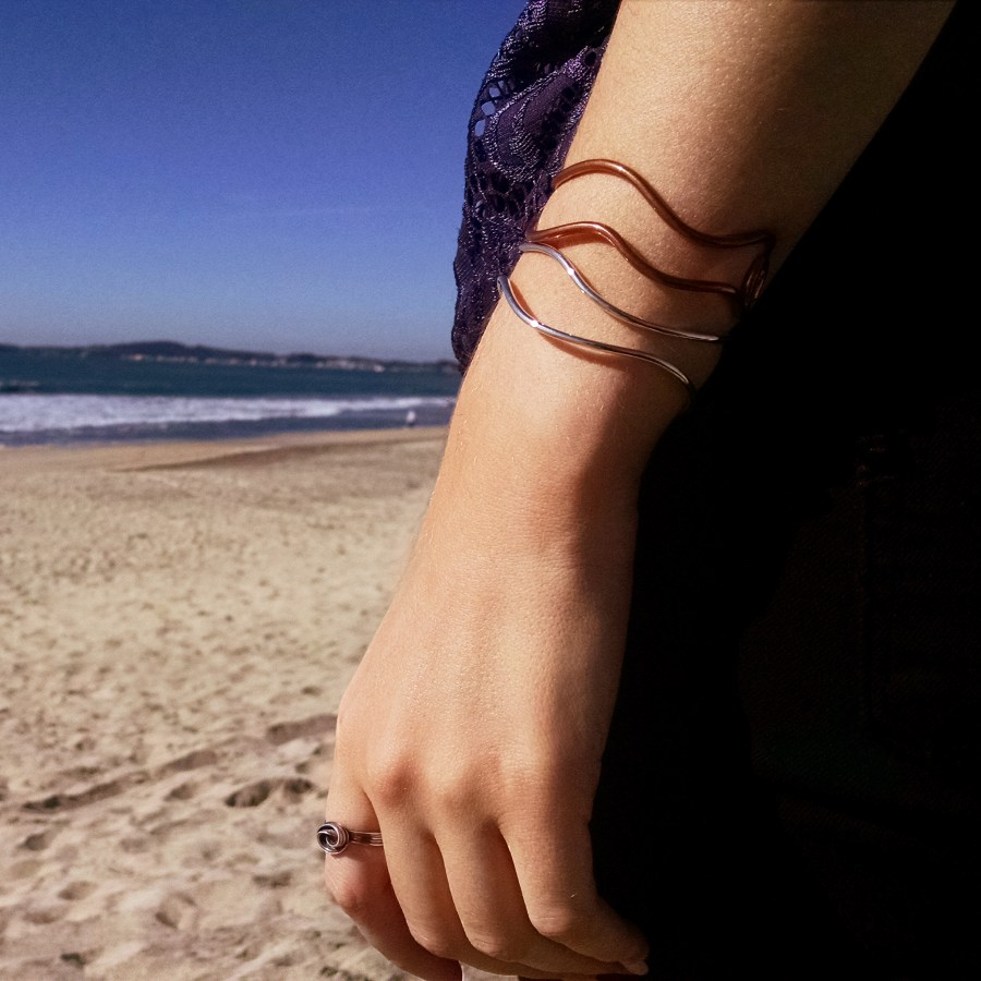 Model wearing Copper and Silver Cuff Bracelets at the beach