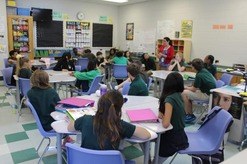 Sixth-graders listen to English Language Arts teacher Tracy Lopez at Faith Middle School, Fort Benning, Ga.