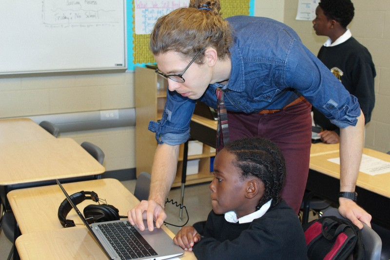 Bodie Manly helps Jarmon James, 12, with fractions in advance of a PARCC-like practice test.