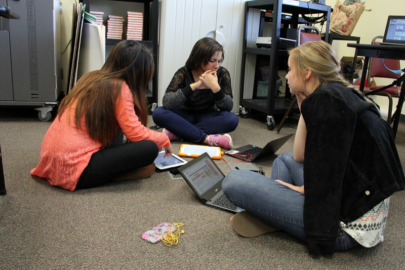 (From left to right) Sophomores Itais Martinez, Makayla Brewington and Madison Riggs work on a group project at Johnston County Early College Academy in Smithfield, N.C. on April 24.