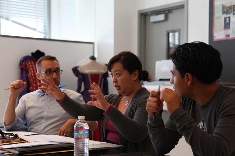 Cathy Kwan (middle) discusses a senior's portfolio defense with assistant principal Matthew Hein (left) and Otoniel Ceballos, a recent graduate of Los Angeles High School of the Arts.