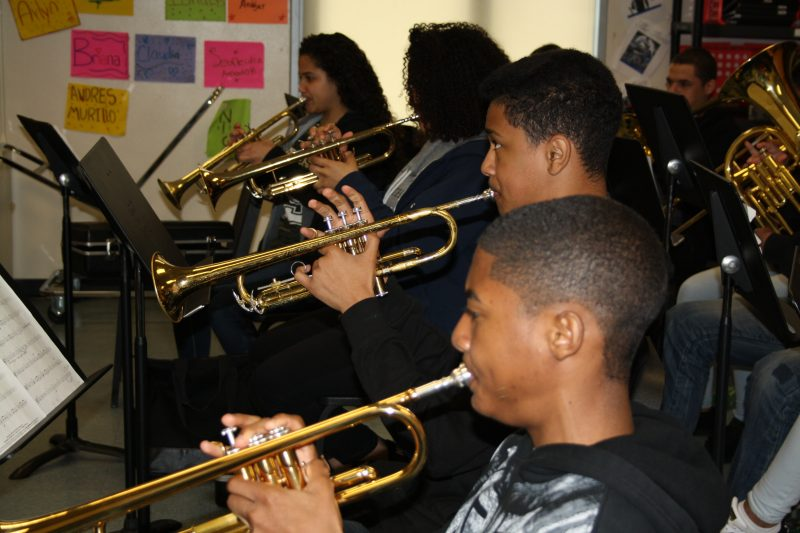 Underclassmen at the Margarita Muñiz Academy prepare for their spring band concert. The arts make up an integral part of this bilingual school's curriculum.