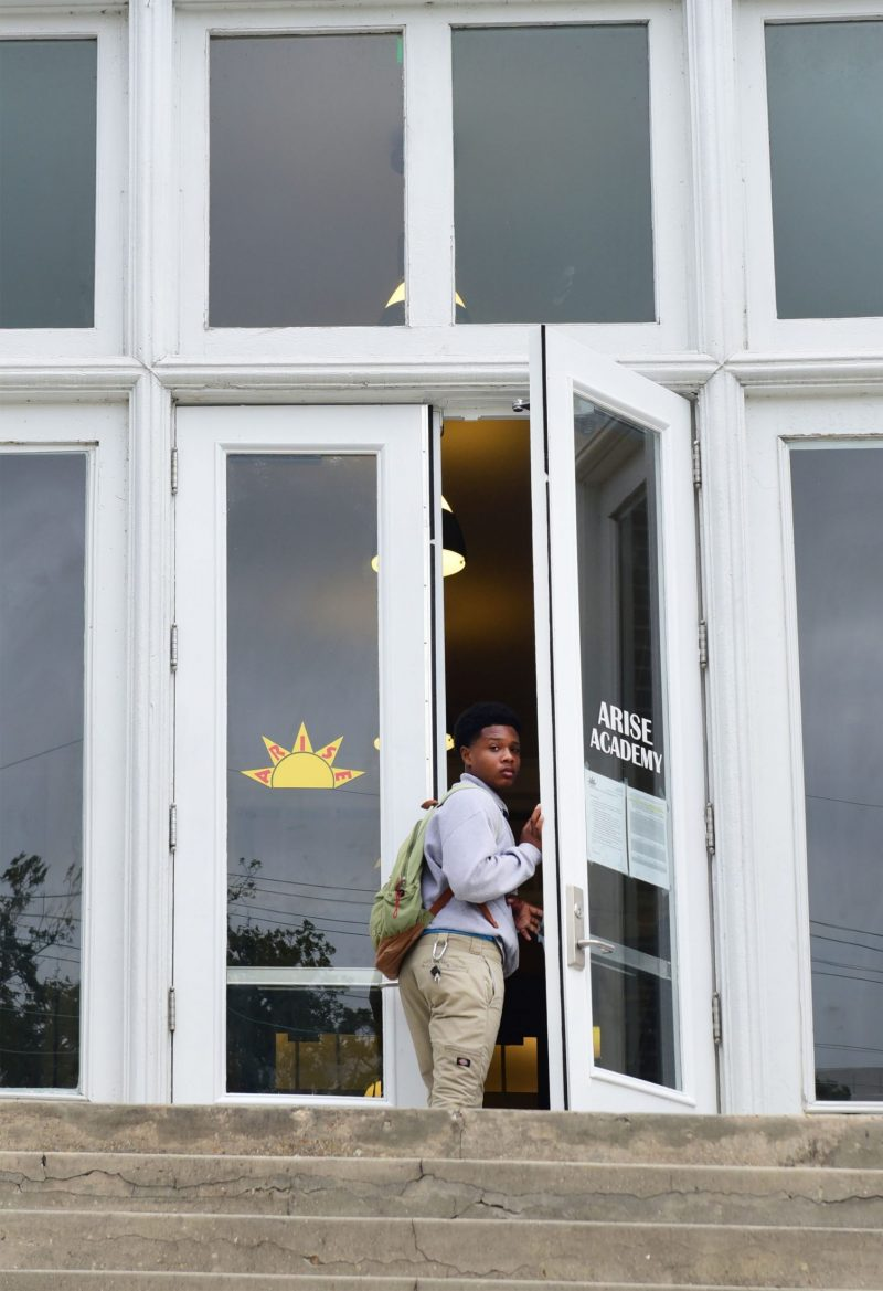 A student arrives late to Arise Academy, one of several New Orleans charter schools that set overly ambitious goals.