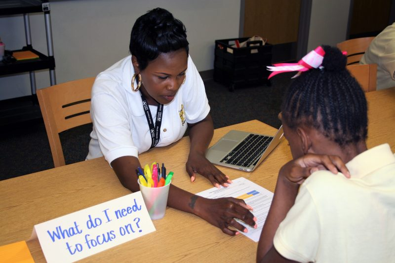 Sylvan Hills Middle School Assistant Principal Tara Cotton discusses performance with a student during a goal-setting exercise in this Atlanta Public School. Empowering students and teachers with data is a key initiative in the district.