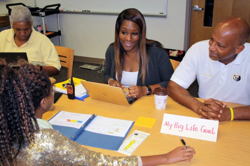 """Sylvan Hills Middle School Assistant Principal Monica Blasingame, center, and Principal Artesza Portee, right, discuss """"big life goals"""" with a student as part of a goal-setting exercise in Atlanta Public Schools."""