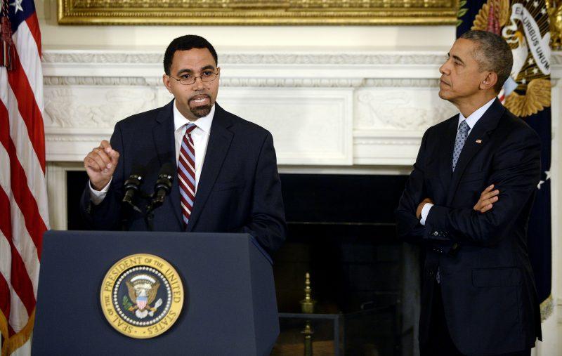 Former United States Deputy Secretary of Education John B. King Jr., speaks as President Barack Obama, right, looks on during an October 2015 event.