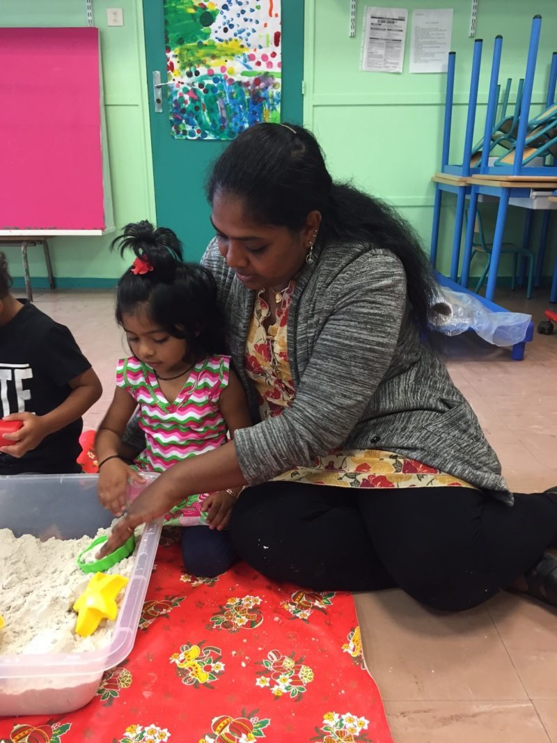 Dieganayaguy Kalaiarasi, an immigrant from India, spends time with her daughter in the 2-year-old classroom at Ecole Albert Camus in the Parisian suburb of Trappes.