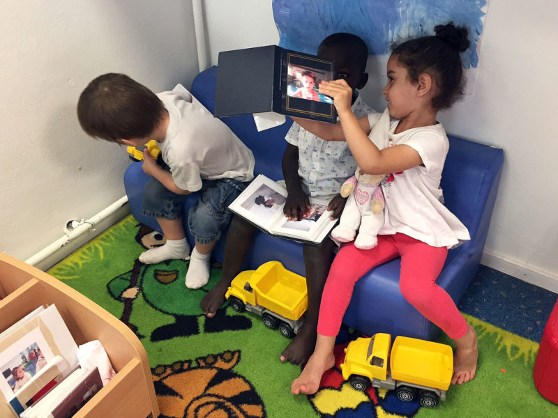 Children share their picture books with each other in the reading corner of the 2-year-old classroom at a preschool in Lormont, a suburb of Bordeaux.