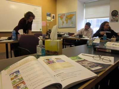Harvard University Bridge Program students go over a workbook exercise in Jennifer Goulart's ESOL class. (Photo by Sarah Butrymowicz)