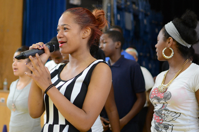 Talizha Jones, rehearsing an eighth-grade graduation song at Brennan-Rogers, wanted to switch schools when students were required to attend for nearly eight hours a day. (Photo: Melissa Bailey)
