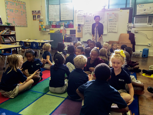 Tiana Nobile, co-president of the new United Educators Morris Jeff teachers union, starts the day with her kindergarten class on October 28, 2014. Teachers at Morris Jeff Community School in New Orleans voted to unionize last year, making them the first to do so in a city that has had virtually no union representation since Hurricane Katrina. (Photo: Alex Neason)