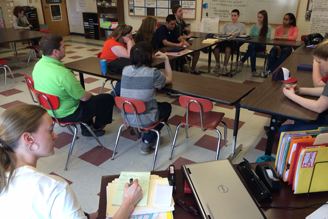 Pittsfield Middle High School English teacher Jenny Wellington observes a student-led discussion. (Photo: Emily Richmond)