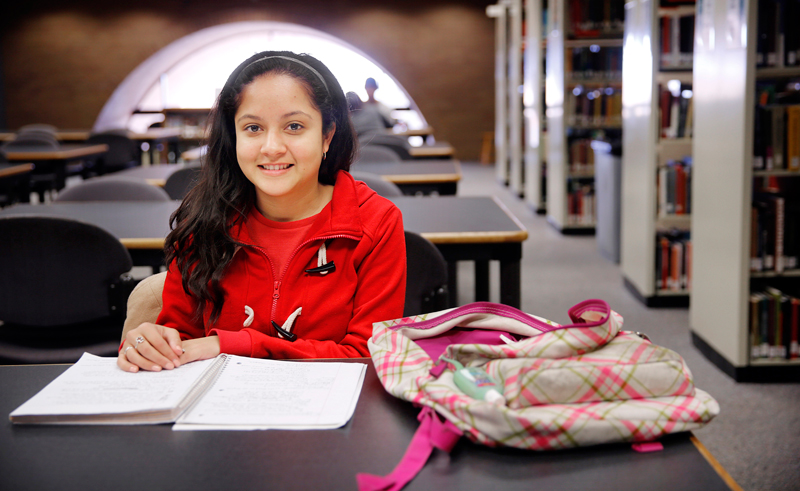 Freshman Esmeralda Rosas of Dallas is going to the University of North Texas because of the Emerald Eagle Scholar program, an affordable education plan for lower-income families. Here she is photographed in the campus library where she comes to study, Monday, January 27, 2014. (Tom Fox/The Dallas Morning News)
