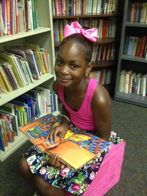Cayden Taylor, 11, in the library of Operation Shoestring in Jackson, Miss. (Photo: Nick Chiles)