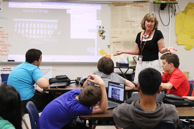 Seventh-grade social studies teacher Jennifer Harmsen reviews lessons in an online video on Roman life with her students at Hillsborough Middle School. (Photo: Meghan E. Murphy)