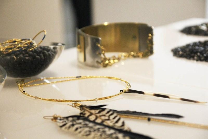 Shopper admiring the jewelry of Adele Dejak