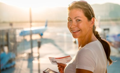 Woman with passport headed for plane