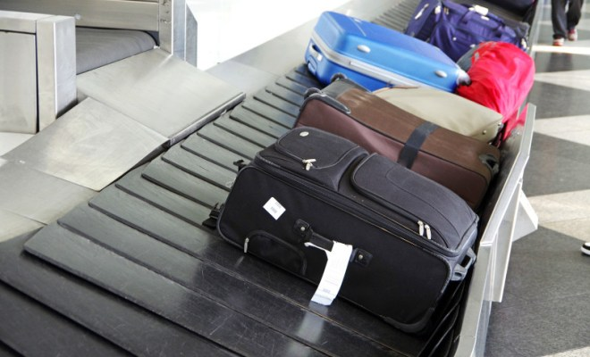 checked luggage on baggage carousel