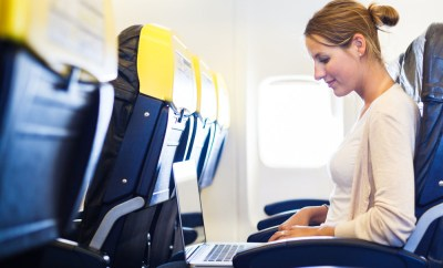 women inflight internet laptop