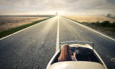 vintage convertible woman on open road