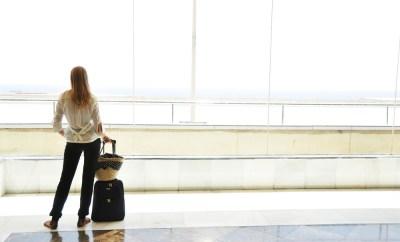 woman airport carryon