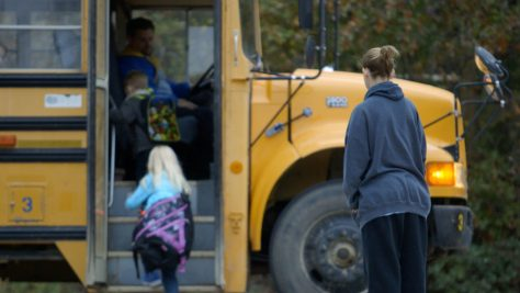 Shawna Baldwin, sex offender, watches her children board a school bus.