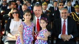 File Photo: Turkish President Recep Tayyip Erdogan (L) speaks with Turkish Cypriot leader Mustafa Akinci (C) and his wife Meral ( R ) during a military parade in Turkish occupied Nicosia, Cyprus, 20 July 2015. Φωτογραφία ΤΟΥΡΚΙΚΗ ΠΡΟΕΔΡΙΑ