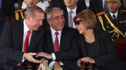 FILE PHOTO: Turkish President Recep Tayyip Erdogan (L) speaks with Turkish Cypriot leader Mustafa Akinci (C) and his wife Meral ( R ) during a military parade in Turkish occupied Nicosia, Cyprus, 20 July 2015. EPA, STRINGER
