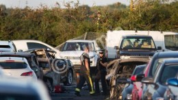 Emergency services inspect the crash site at Blackbushe Airport in Hampshire, after four people died when a private Phenom 300 jet crash-landed in a car auction site and burst into flames as it approached the runway in Farnborough, Britain, 31 July 2015. The Saudi General Authority of Civil Aviation has confirmed that the plane was a Saudi-registered jet.  Photo via ΑΠΕ-ΜΠΕ, EPA/DANIEL LEAL-OLIVAS