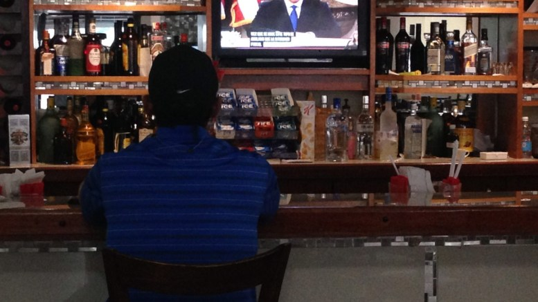 A man watches a TV broadcasting Puerto Rico's Governor Alejandro Garcia Padilla delivering a televised message to the nation, in San Juan, Puerto Rico. EPA/JORGE MUNIZ BEST QUALITY AVAILABLE