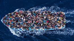 "Hundreds of refugees and migrants aboard a fishing boat are pictured moments before being rescued by the Italian Navy as part of their Mare Nostrum operation in June 2014. The Italian Coastguard / Massimo Sestini / Photo via ""un.org"""