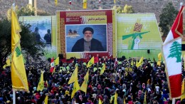 FILE PHOTO: Hezbollah supporters wave Hezbollah flags as they listen to the speech of Hezbollah leader Hassan Nasrallah. EPA/STR