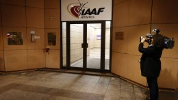 FVTOGRAFIA ARXEIOYq A journalist takes a picture of the entrance to the IAAF (The International Association of Athletics Federations) headquarters in Monaco. Russia is ready to step up its anti-doping efforts and hopes for a reasonable decision by the ruling athletics body IAAF which votes on a possible suspension of Russia for events including the 2016 Olympics, Sport Minister Vitaly Mutko said. EPA, SEBASTIEN NOGIER