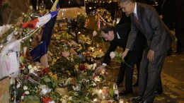 FILE PHOTO: US President Barack Obama (R) and French President Francois Hollande (2-R) pay tribute to the victims of the 13 November attacks in front of the Bataclan concert venue, on the eve of the opening of the COP21 Conference, Paris, France, 29 November 2015. EPA, PHILIPPE WOJAZER, POOL