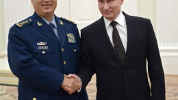 Russian President Vladimir Putin (R) shakes hands with Vice Chairman of China's Central Military Commission Xu Qiliang during their meeting in the Kremlin in Moscow, Russia. EPA, ALEXEY NIKOLSKIY, SPUTNIK, KREMLIN POOL