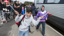 Migrants, mainly from Syria, at Padborg station, Denmark. EPA/CLAUS FISKER DENMARK OUT