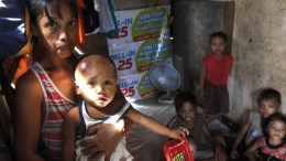 File Photo: Filipino mother displays her youngest child suffering from a skin disease. EPA, FRANCIS R. MALASIG
