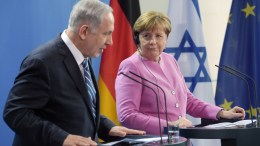 FILE PHOTO: German Chancellor Angela Merkel (R) and Israel's Prime Minister Benjamin Netanyahu (L) during a press conference on the German-Israeli government consultations at the Federal Chancellery in Berlin, Germany, 16 February 2016. EPA, RAINER JENSEN