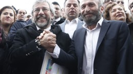 FILE PHOTO: Can Dundar (L), editor of the Cumhuriyet newspaper and Cumhuriyet Ankara bureau chief Erdem Gul (R). EPA, SEDAT SUNA