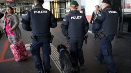 Austrian police officers with a sniffer dog on duty. EPA/CHRISTIAN BRUNA