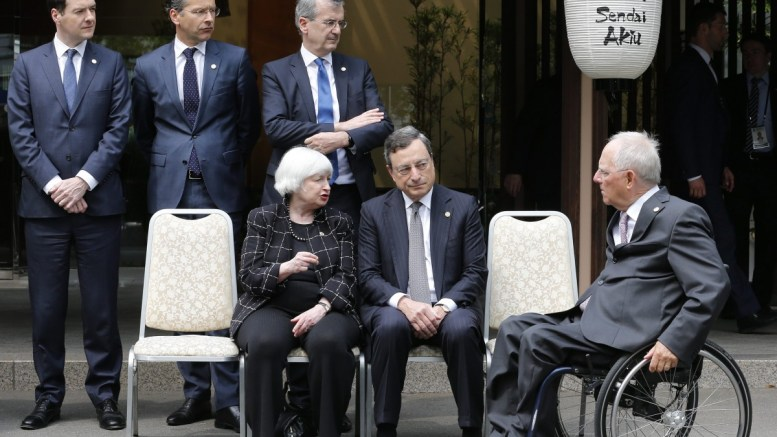 FILE PHOTO: German Federal Minister of Finance Wolfgang Schauble (R) takes his position as US Federal Reserve Board Chair Janet Yellen (Front L) and European Central Bank President Mario Draghi (Front C) talk at the start of a group photo session of the G7 Finance Ministers and Central Bank Governors meeting at Akiu in Sendai, Miyai Prefecture, northern Japan. EPA, KIMIMASA MAYAMA
