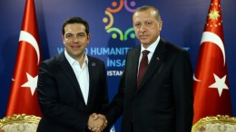 FILE PHOTO: A file picture provided by Turkish President Press office shows, Turkish President Recep Tayyip Erdogan (R) shake hands with Greek Prime Minister Alexis Tsipras (L).  EPA, TURKISH PRESIDENT PRESS OFFICE
