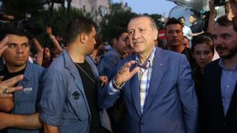 FILE PICTURE. Turkish President Recep Tayyip Erdogan (C) waves to his supporters.   TURKEY OUT EPA, STR TURKEY OUT