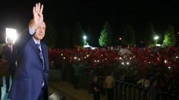 FILE PHOTO: A handout picture provided by the Turkish Presidential Press office shows, Turkish President Recep Tayyip Erdogan (L) waving during a rally to denounce the failed coup attempt and to mourn the 240 fatalities, including civilians, policemen, and soldiers, in front of the Presidential Palace in Ankara, Turkey, 10 August 2016. EPA, TURKISH PRESIDENT PRESS OFFICE