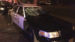 A handout picture made available by the Milwaukee Police Department shows a damaged police car after violence broke out in Milwaukee, Wisconsin, USA. A Milwaukee Police officer fatally shot a fleeing armed suspect on 13 August, according to the Milwaukee Police Department. According to local media reports, violence broke out after the incident with several fires and reported gunshots. EPA/MILWAUKEE POLICE DEPARTMENT / HANDOUT -- BEST QUALITY AVAILABLE -- HANDOUT EDITORIAL USE ONLY/NO SALES
