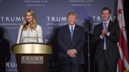 File Photo: Donald Trump (C), with and son Donald Trump Jr.(R), listens as his daughter Ivanka Trump. EPA, SHAWN THEW