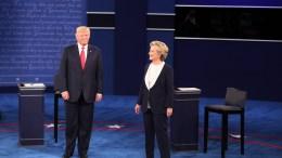 File Photo: Donald Trump (L) and then Democrat Hillary Clinton (R). EPA, JIM LO SCALZO