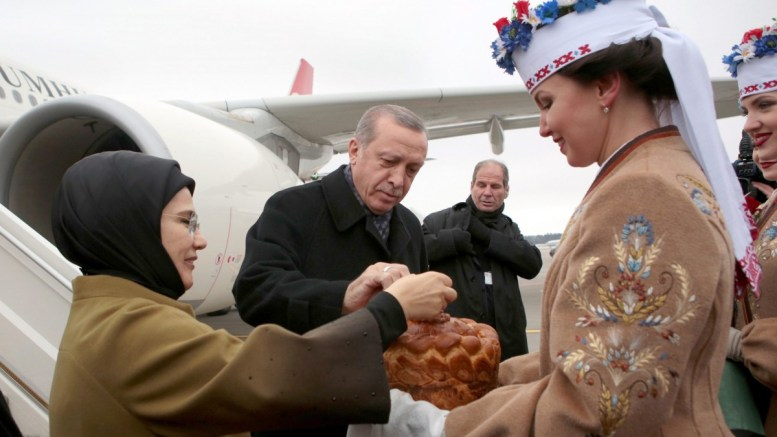 File PHOTO: Turkish President Recep Tayyip Erdogan (C) and his wife Emine Erdogan (L) taste welcoming bread and salt, as they arrived at the airport in Minsk, Belarus. EPA, OXANA MANCHUK, BELTA, POOL