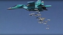 A handout still image taken from video footage shows a Russian Sukhoi Su-34 fighter- releasing its payload while carrying out airstrikes in Syria. FILE PHOTO. EPA/RUSSIAN DEFENCE MINISTRY PRESS SERVICE / HANDOUT BEST QUALITY AVAILABLE/ HANDOUT EDITORIAL USE ONLY/NO SALES