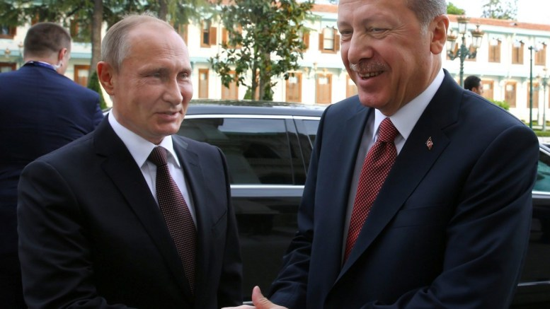 A handout picture provided by the Turkish Presidential Press office shows Russian President Vladimir Putin (L) being welcomed by Turkey's President Recep Tayyip Erdogan (R). EPA/TURKISH PRESIDENTIAL PRESS OFFICE/HANDOUT HANDOUT EDITORIAL USE ONLY/NO SALES